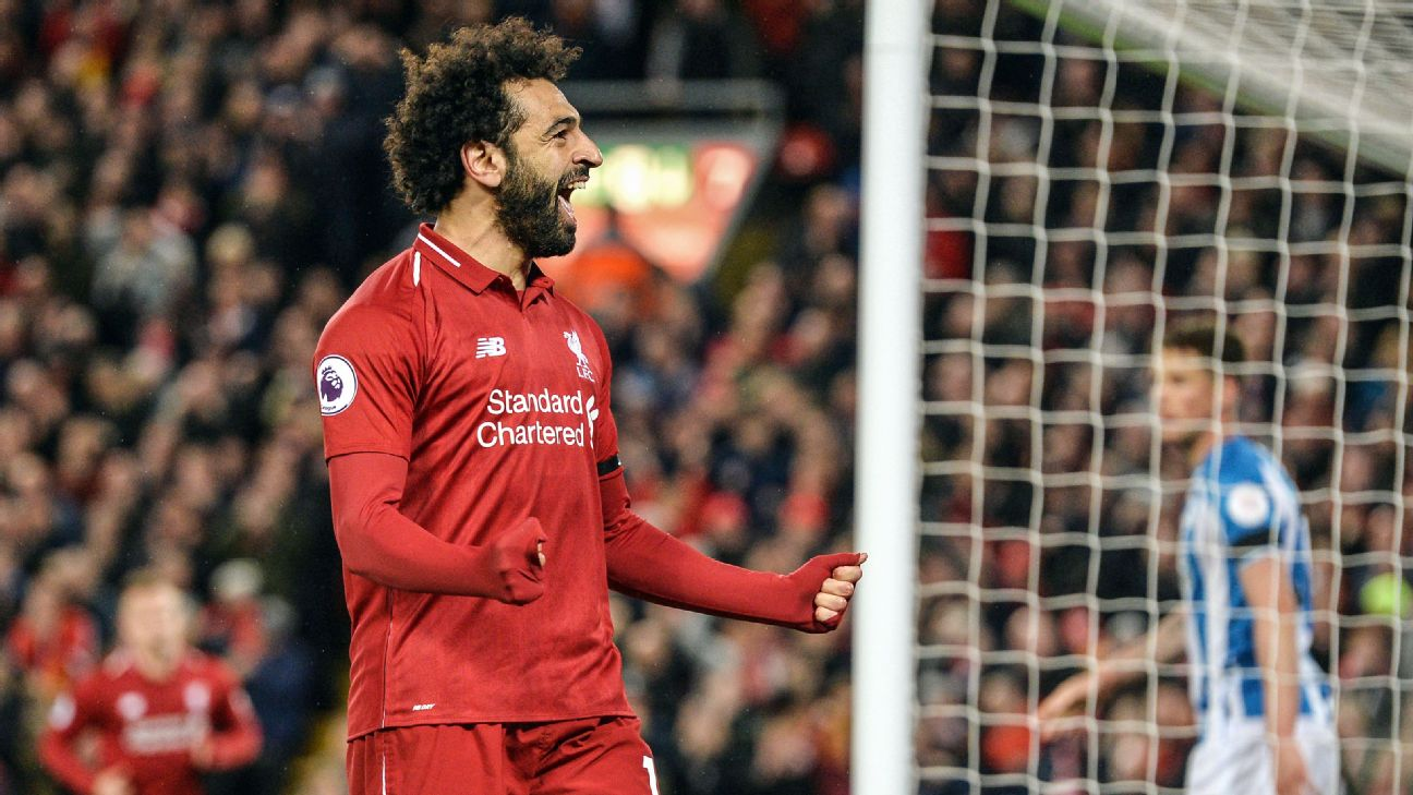Mohamed Salah celebrates during Liverpool's Premier League win over Huddersfield.