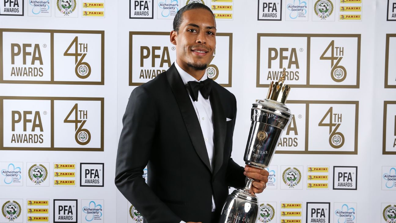 Virgil van Dijk poses for photos with the PFA Player of the Year award.