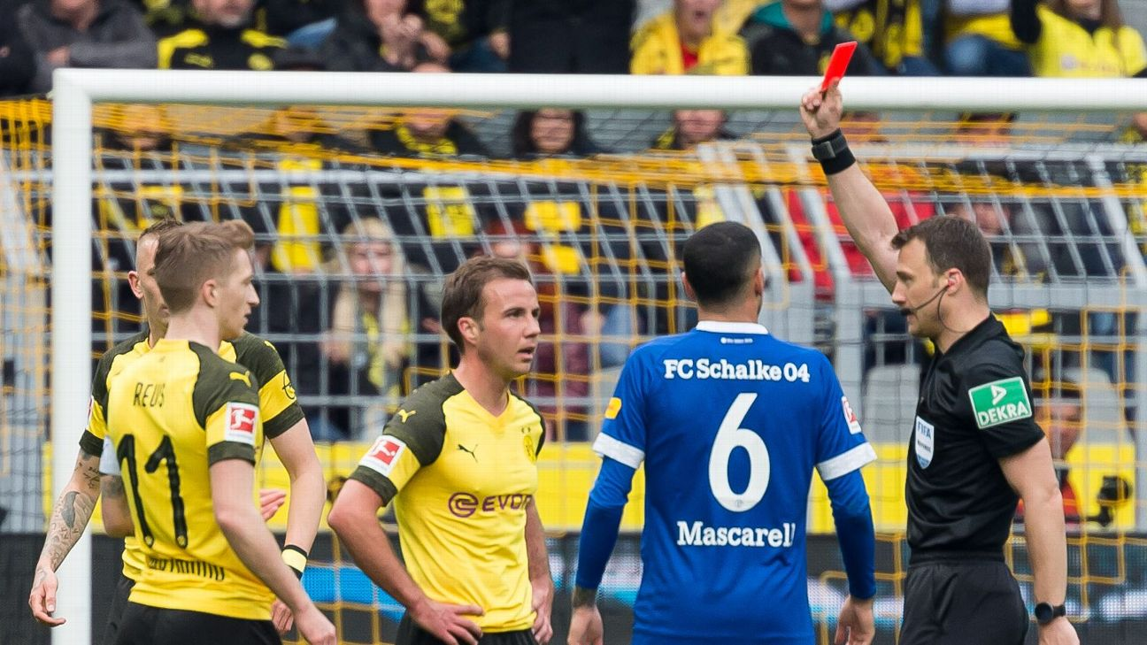 Dortmund's Marco Reus will miss two matches after being shown a straight red card against Schalke.