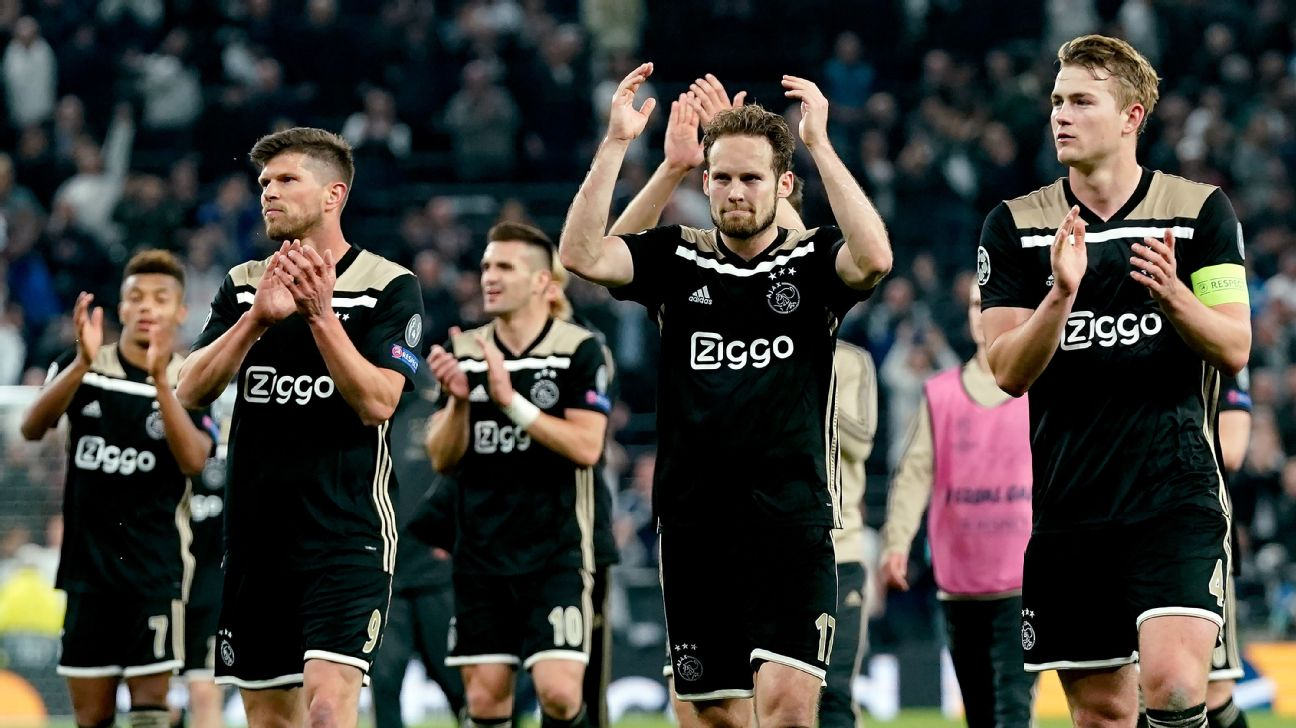Ajax players applaud their travelling supporters after a Champions League win against Tottenham.