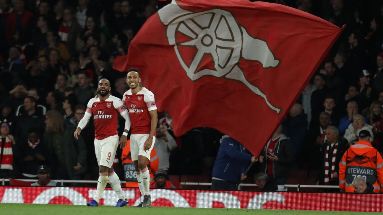 Alexandre Lacazette and Pierre-Emerick Aubameyang celebrate during Arsenal's Europa League win over Valencia.