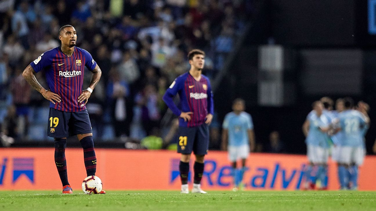 Kevin-Prince Boateng, left, reacts during Barcelona's La Liga loss to Celta Vigo