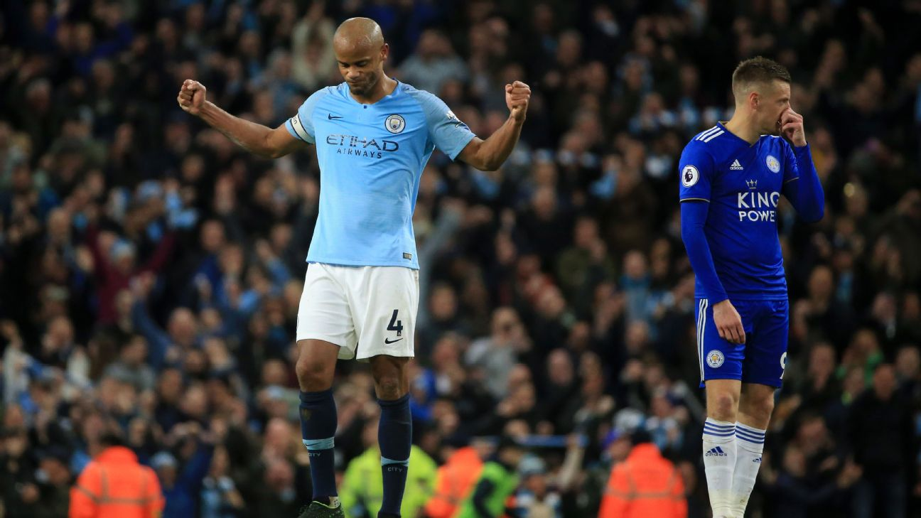 Vincent Kompany celebrates after Manchester City's Premier League win over Leicester.