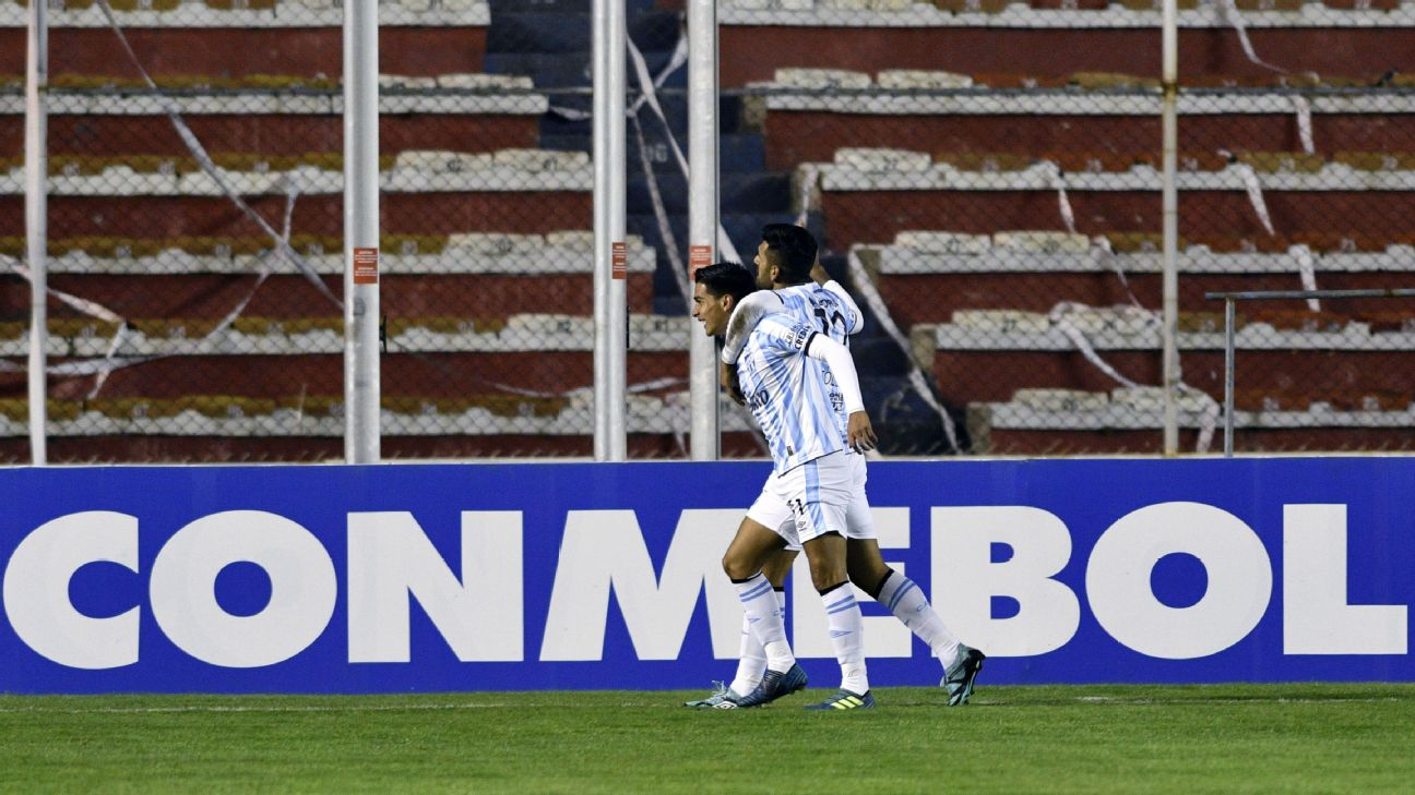 Favio Alvarez, left, celebrates after scoring a goal for Atletico Tucuman.