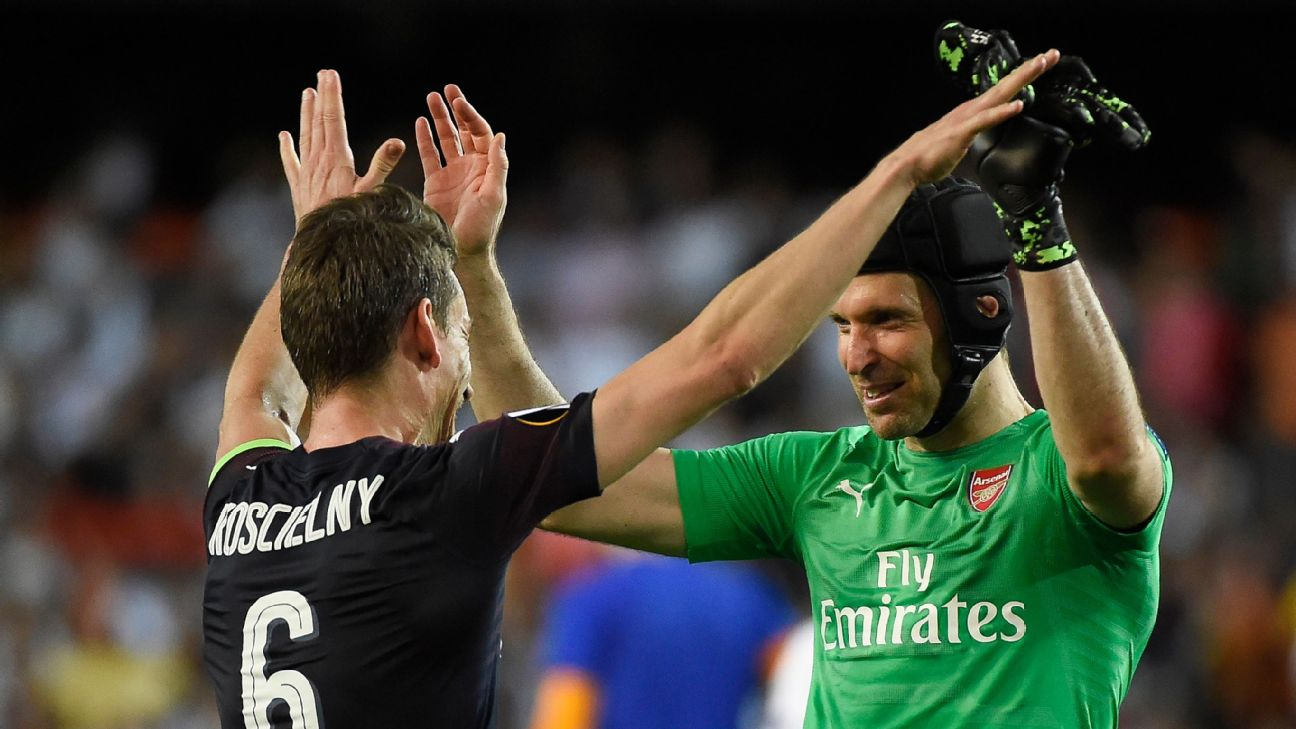 Arsenal keeper Petr Cech, right, celebrates with Laurent Koscielny after reaching the Europa League finals.