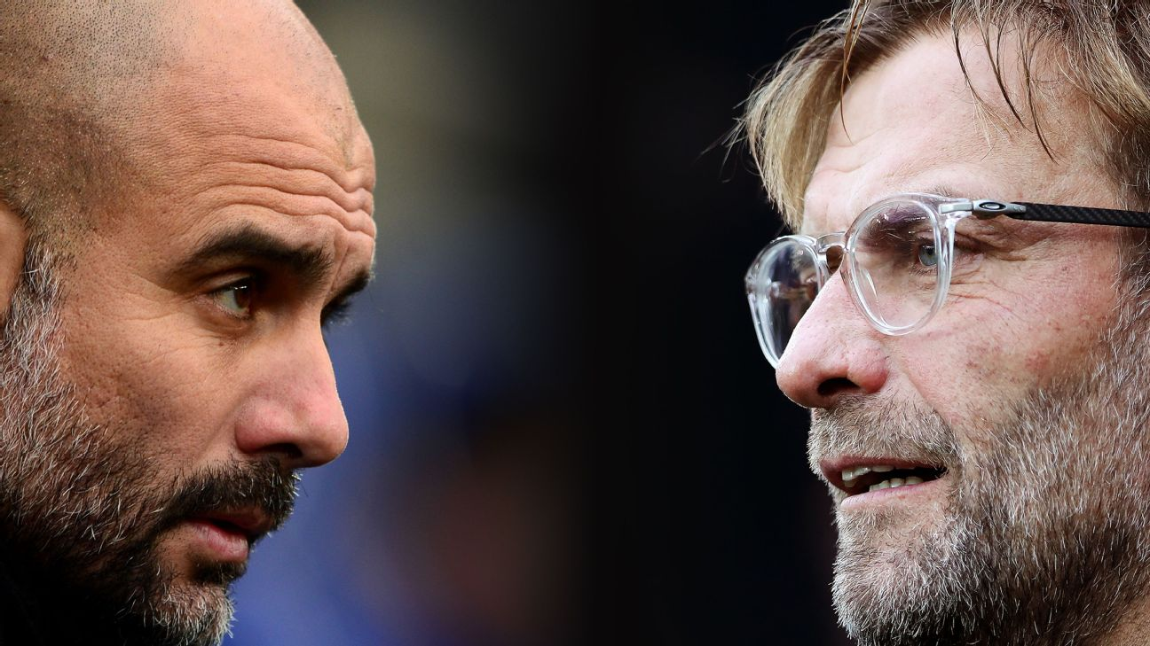 Josep Guardiola, Manager of Manchester City (L) and Liverpool manager Jurgen Klopp.