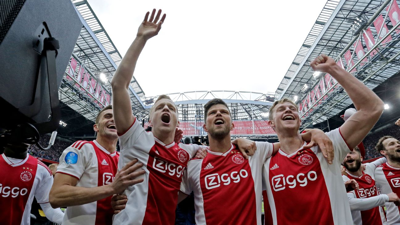 Ajax players celebrate after winning a match against Utrecht in the Eredivisie.