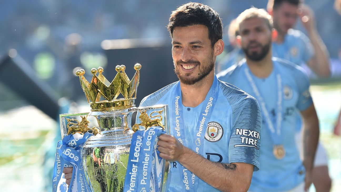 David Silva holds the Premier League trophy after Manchester City defeated Brighton & Hove Albion to clinch the 2018-19 title.