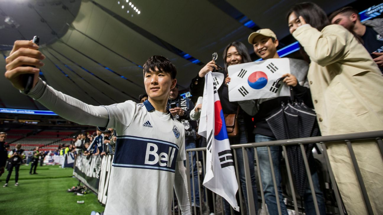 Inbeom Hwang poses for a photo with fans after a Vancouver Whitecaps match at BC Place.