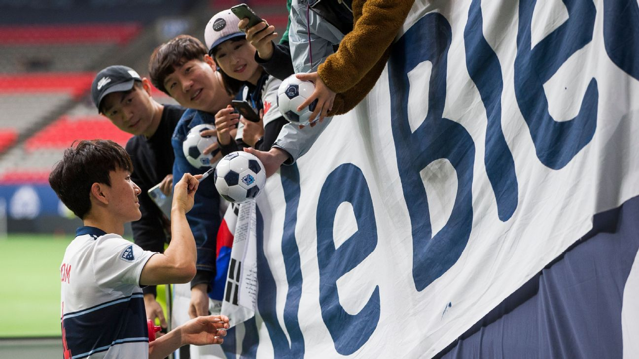 Inbeom Hwang signs autographs after the Vancouver Whitecaps' MLS match against the Philadelphia Union.