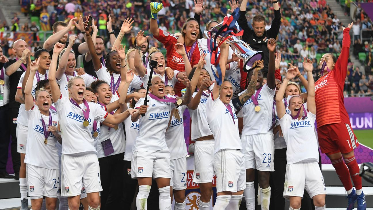 Lyon players celebrate with the trophy after beating Barcelona 4-1 in the UEFA Women's Champions League final.