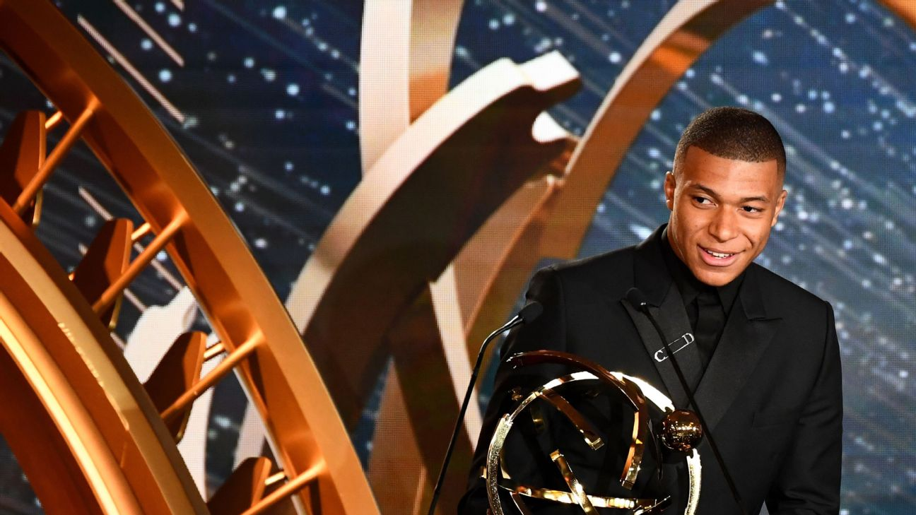 PSG forward Kylian Mbappe addresses the audience after winning the Ligue 1 Player of the Year award.
