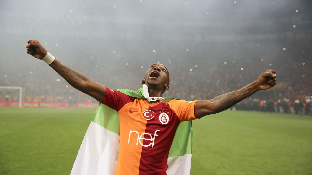 Henry Onyekuru, draped in the Nigeria flag, celebrates winning the Turkish Super Lig with Galatasaray, a sharp turn around in fortunes for the on-loan striker.