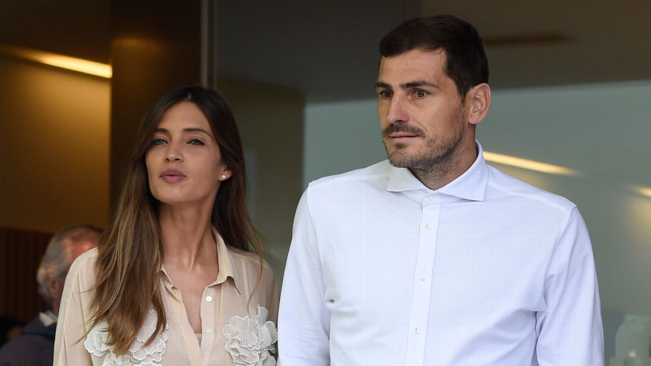 Iker Casillas leaves a hospital with his wife Sara Carbonero