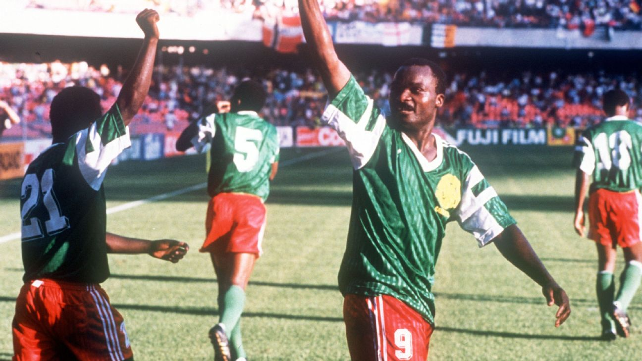 Cameroon legend Roger Milla celebrates the first of his two goals against Colombia at the 1990 FIFA World Cup.