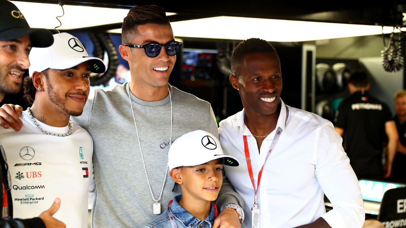 Cristiano Ronaldo and Cristiano Ronaldo Jr. were in attendance for the opening practice of the Monaco Grand Prix and popped into the Mercedes garage to visit Lewis Hamilton.