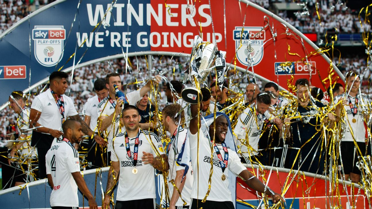 Fulham players celebrate after their Championship Playoff final win over Aston Villa