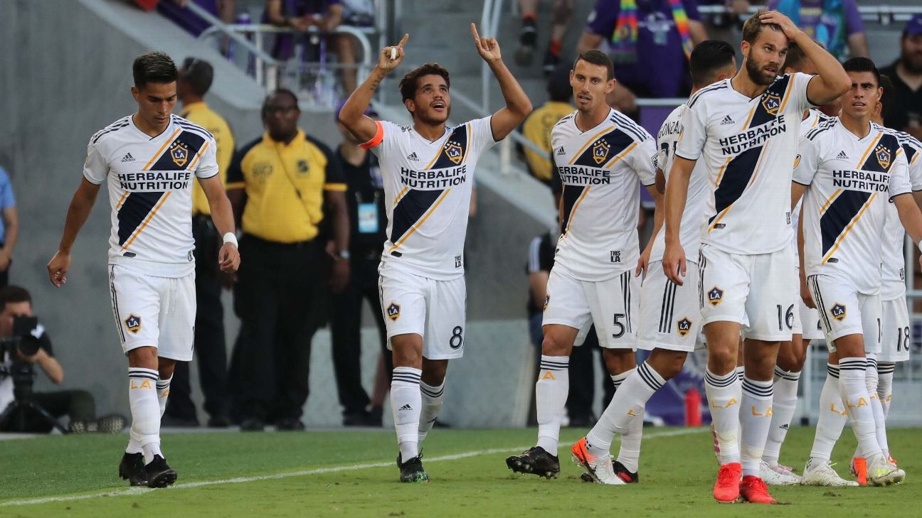 Jonathan Dos Santos, pointing to sky, celebrates after scoring a goal for the LA Galaxy.