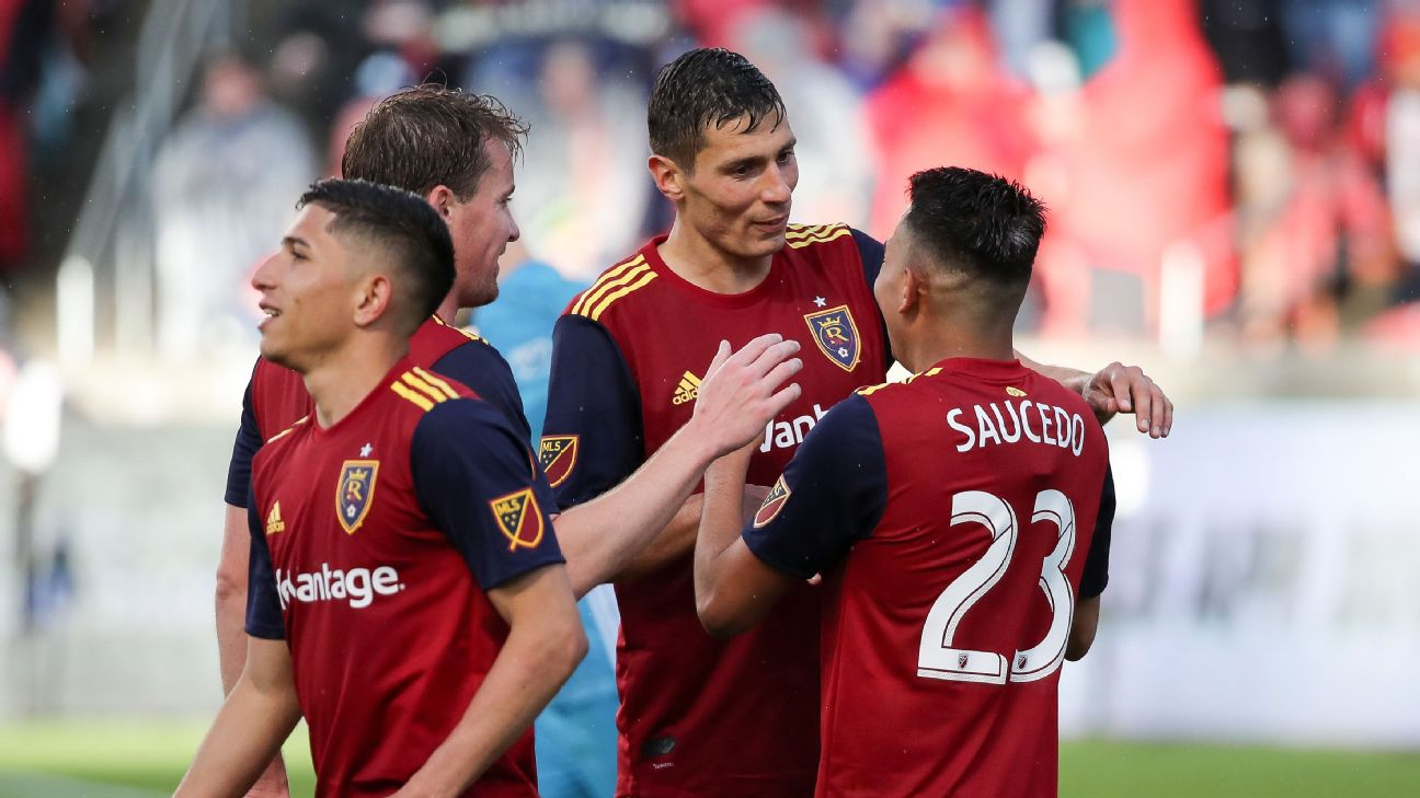 Real Salt Lake players celebrate after scoring a goal against Atlanta United.