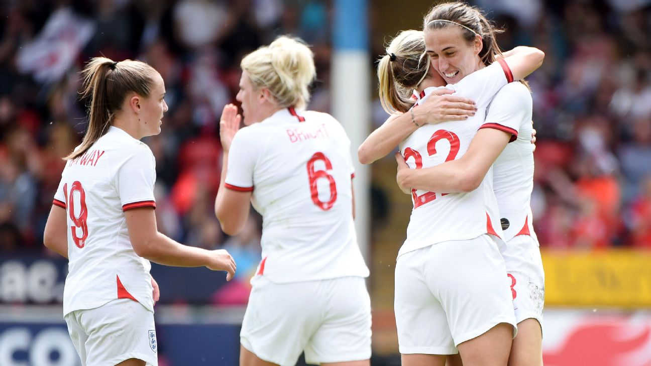 Jill Scott celebrates scoring England's second with her teammates