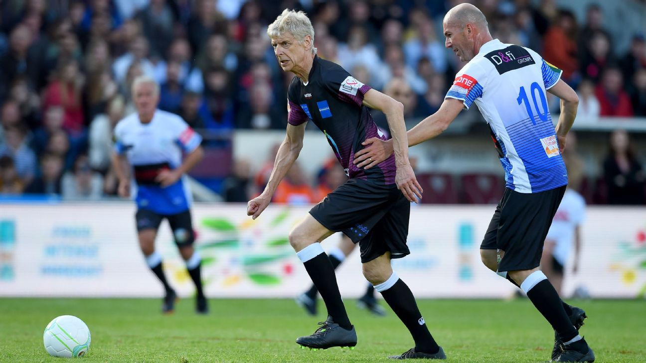 Arsene Wenger, left, and Zinedine Zidane compete for the ball in a charity friendly in Bordeaux, France.