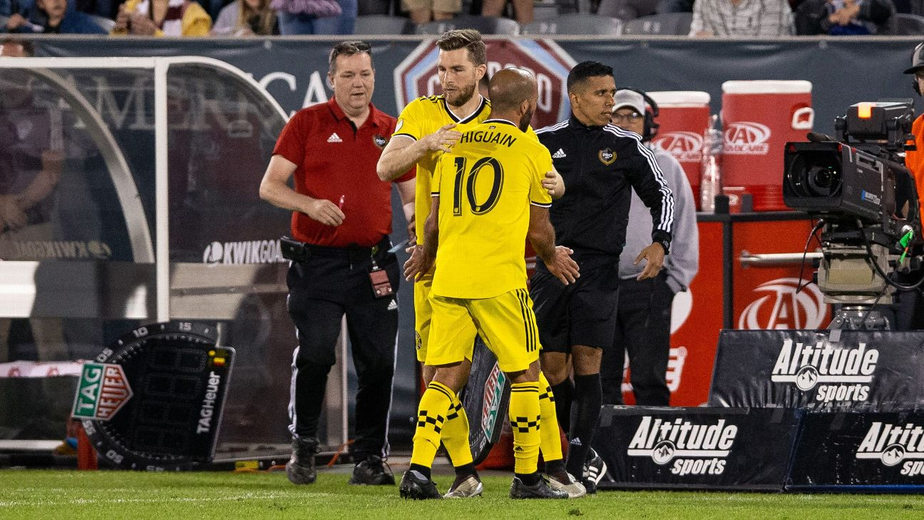 The Columbus Crew's Federico Higuain leaves the field after picking up an injury against the Colorado Rapids.