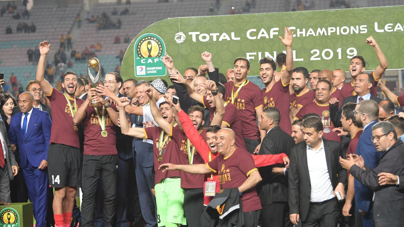 Esperance de Tunis players hold hold up the trophy after winning the CAF Champion League final in controversial fashion.