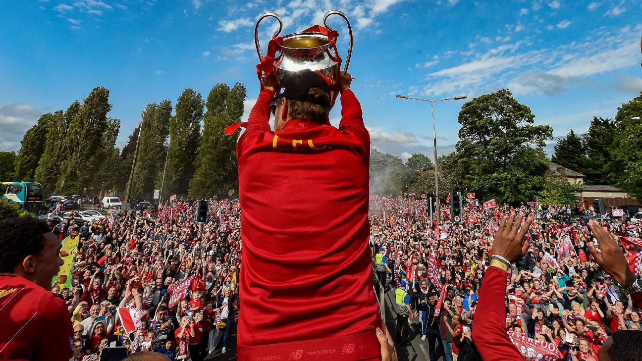 Jurgen Klopp and Liverpool players celebrating after winning the UEFA Champions League at the parade