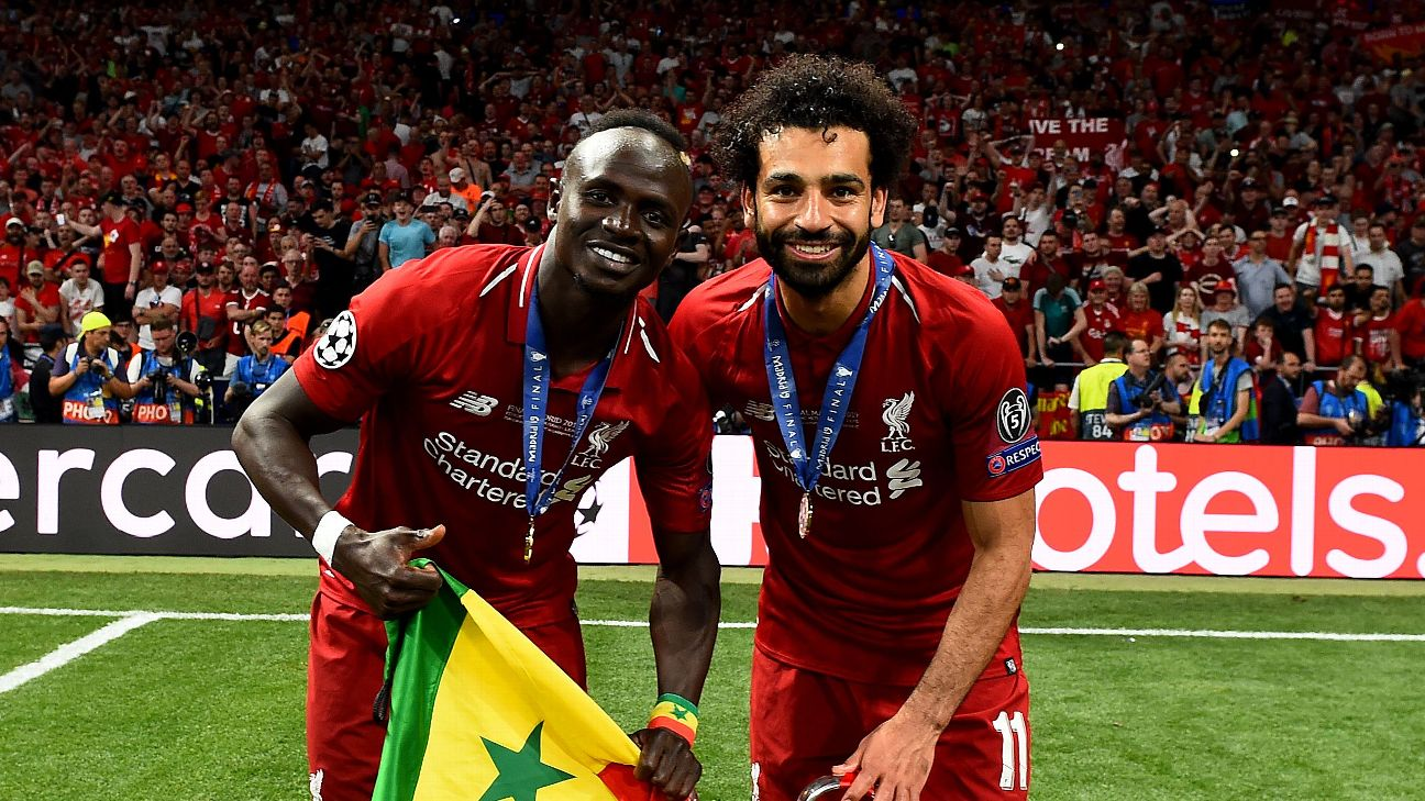 Sadio Mane, holding the Senegal flag, and Mo Salah of Egypt represented Africa with the highest distinction this past season.