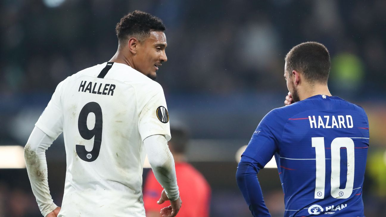 Eintracht Frankfurt striker Sebastien Haller, left, talks to Eden Hazard during a Europa League match.