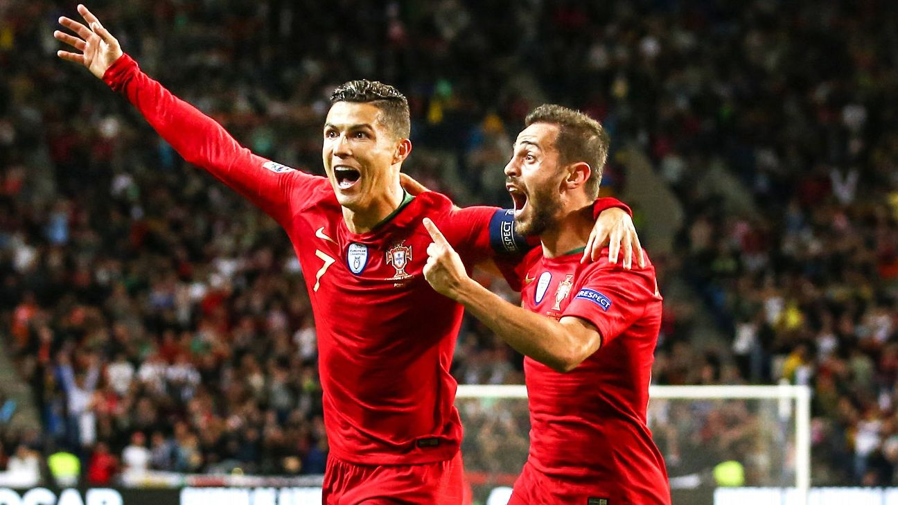 Cristiano Ronaldo and Bernardo Silva celebrate during Portugal's UEFA Nations League semifinal win against Switzerland.