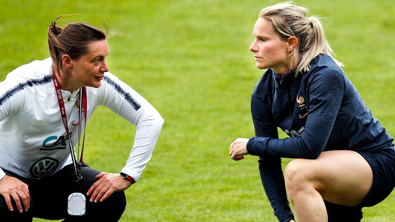 France Women's manager Corinne Diacre, left, talks with captain Amandine Henry during a pre-World Cup training session.