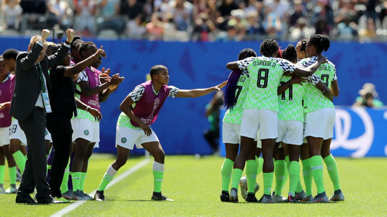 Nigeria players celebrate after Doyeon Kim of Korea Republic scores an own goal,