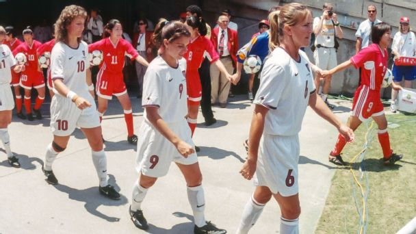 The U.S. and Chinese national teams walk onto the field at the Rose Bowl in Pasadena, California, on July 10, 1999, for the Women's World Cup final.