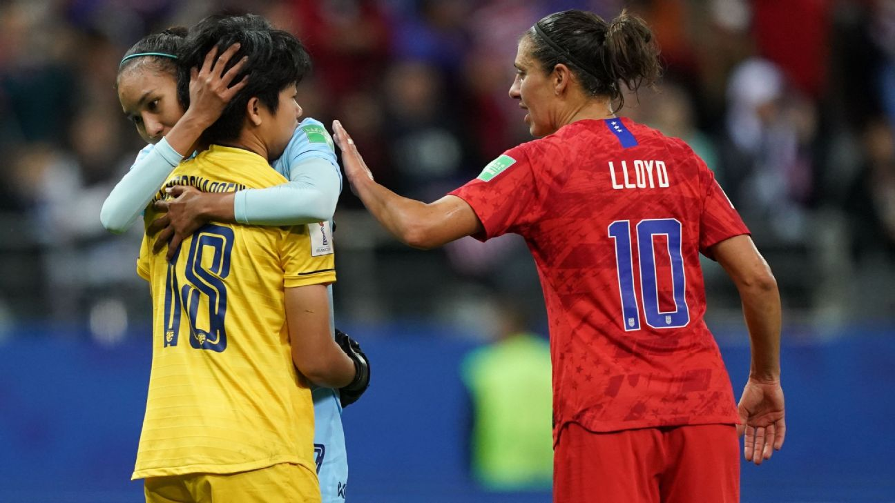 Carli Lloyd encouraged Thailand goalkeeper Sukanya Charoenying after the U.S.'s 13-0 win.