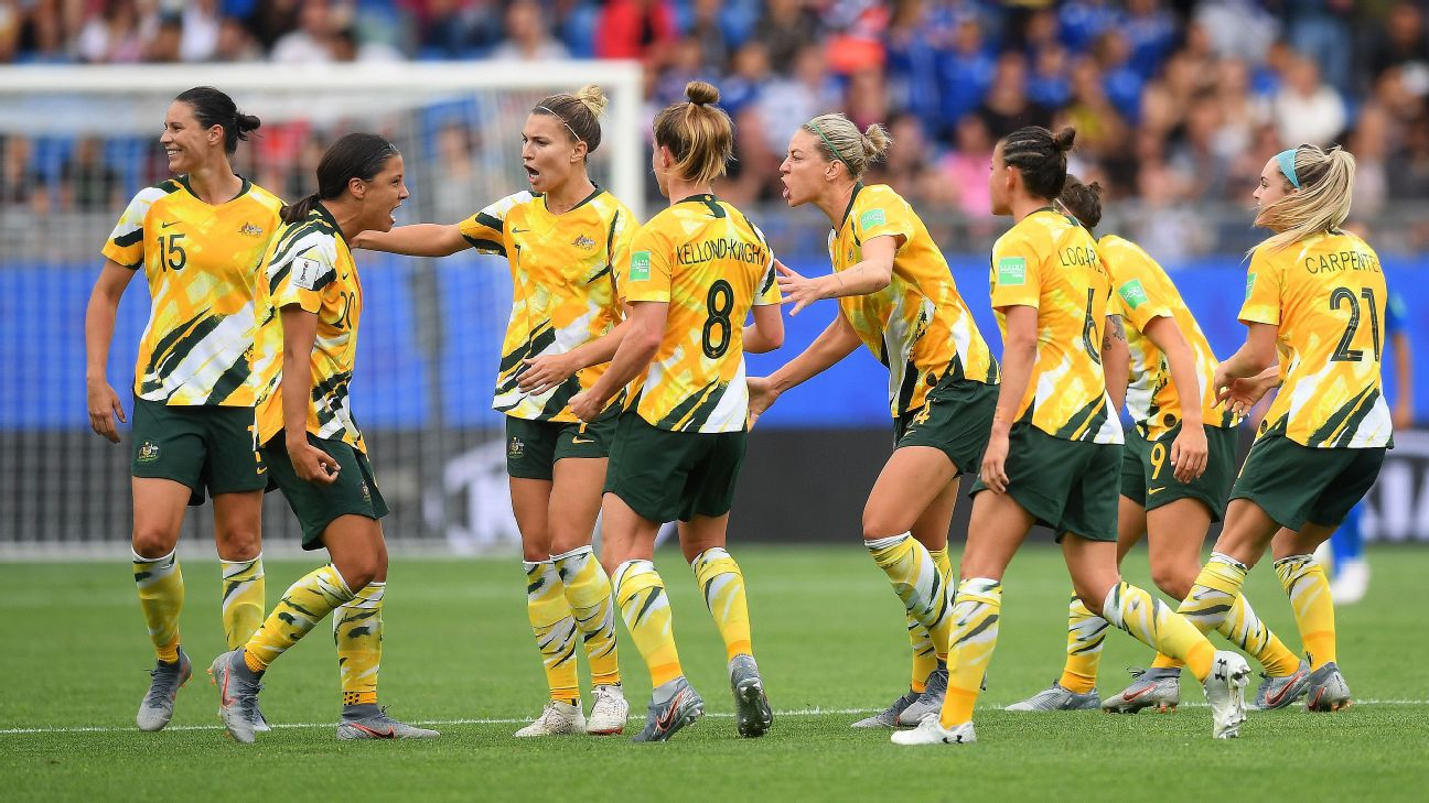 Australia celebrates after taking the lead through a Brazil own goal, thanks to a favorable decision from VAR.