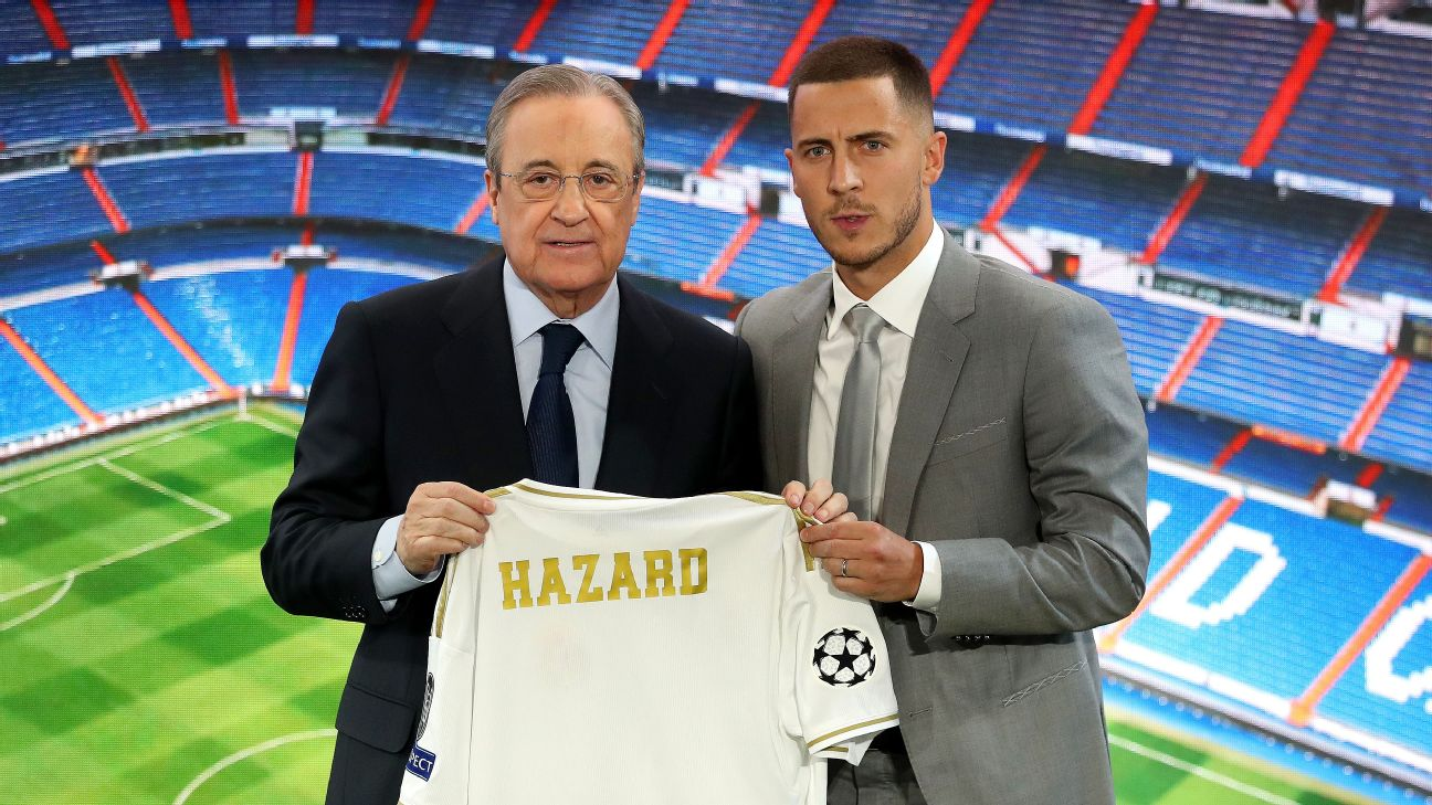 Real Madrid signing Eden Hazard, right, poses with club president Florentino Perez at his unveiling on Thursday.