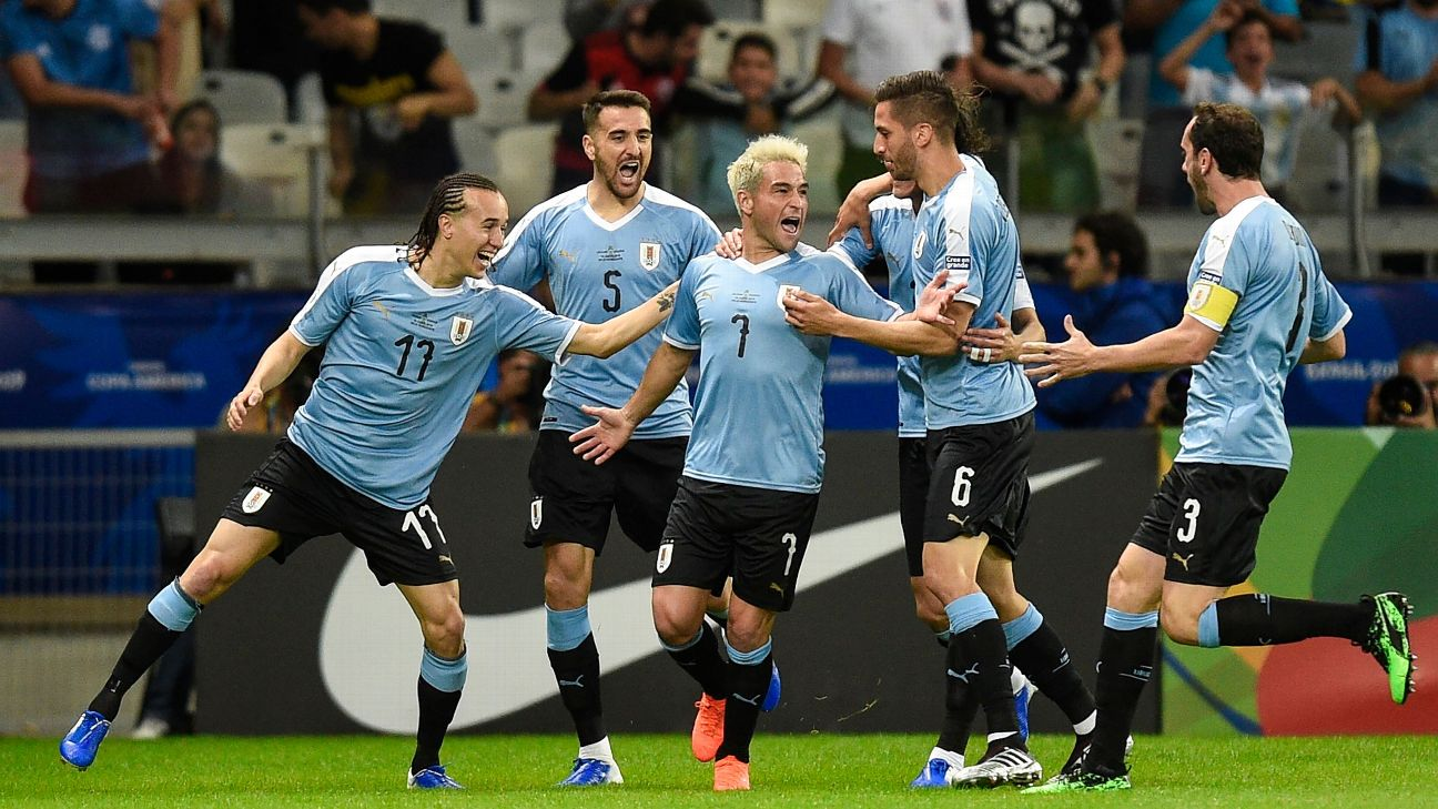 Uruguay's Matias Vecino, second from left, will miss the rest of the Copa America after picking up a thigh injury against Ecuador.