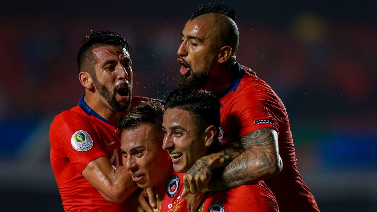 Chile players celebrate after scoring a goal against Japan in the Copa America.