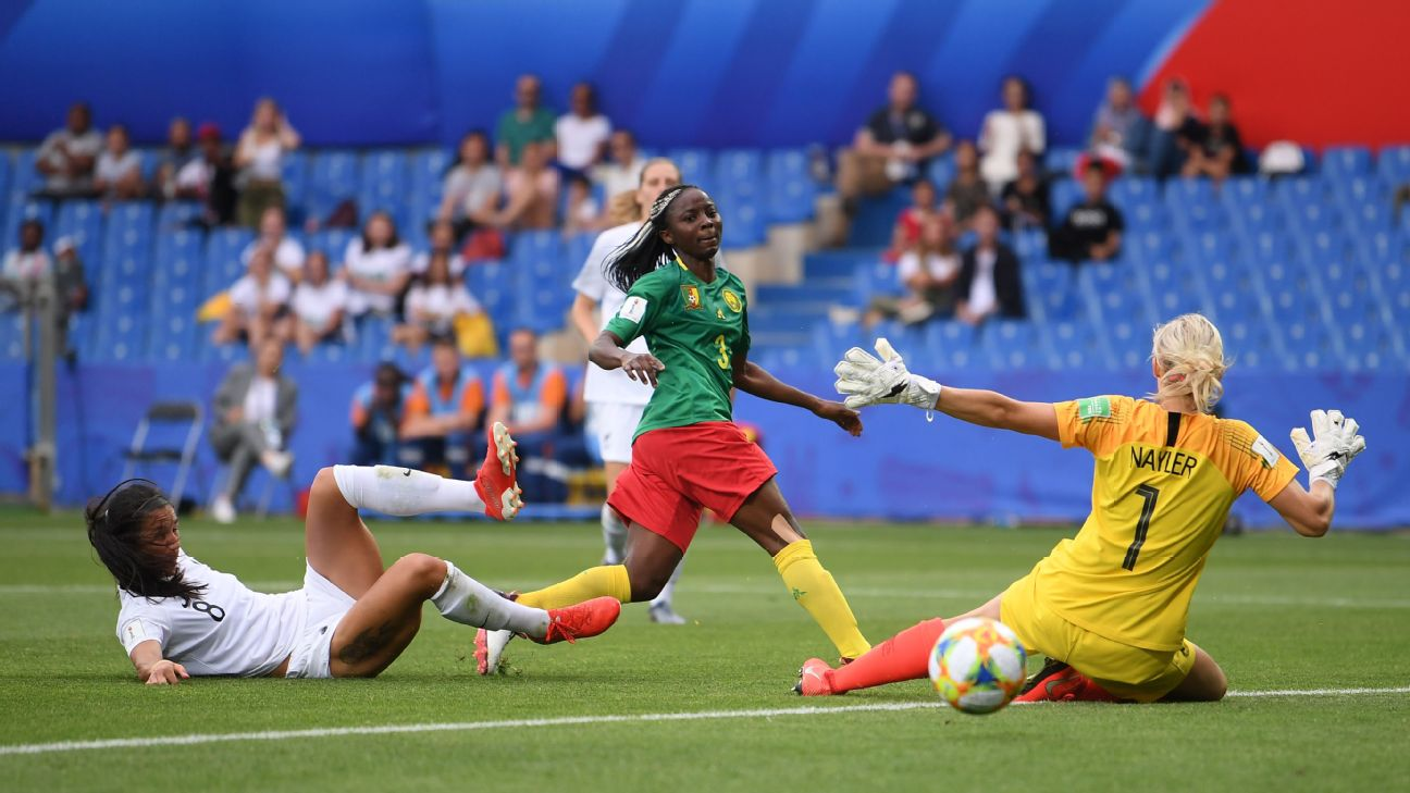 Ajara Nchout of Cameroon scores a goal against New Zealand at the Women's World Cup.