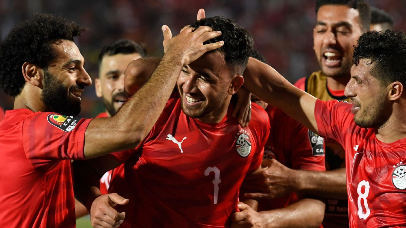 Egypt players celebrate during their Africa Cup of Nations group-stage win over Zimbabwe.