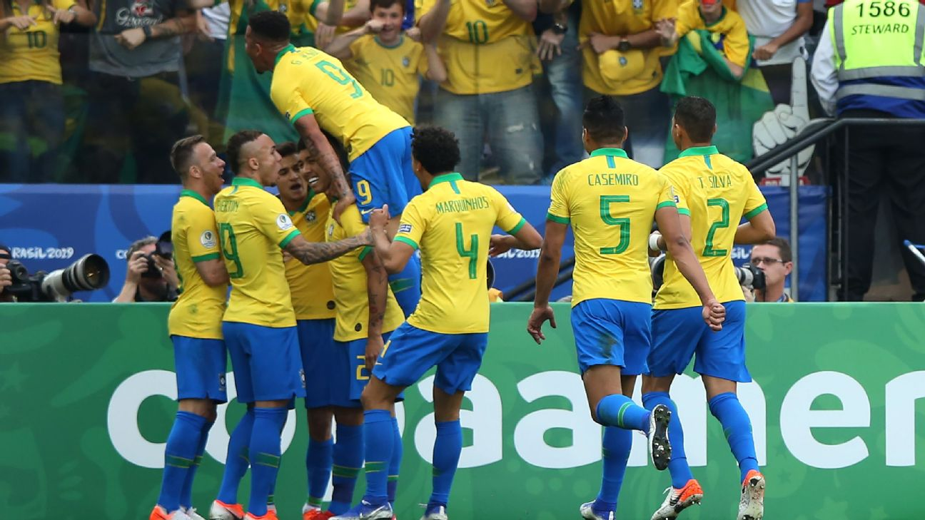Brazil players celebrate after scoring in their Copa America group-stage match against Peru.