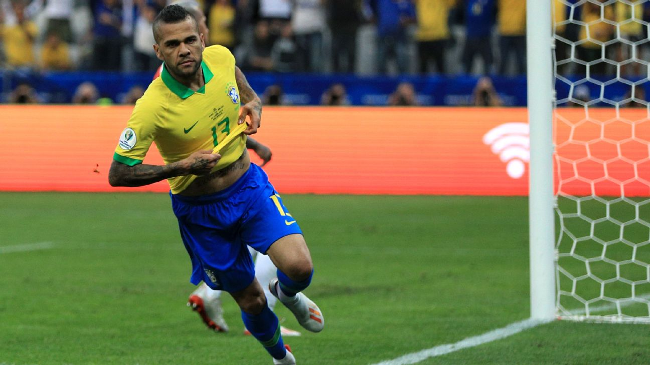 Dani Alves celebrates after scoring in Brazil's Copa America group-stage match against Peru.