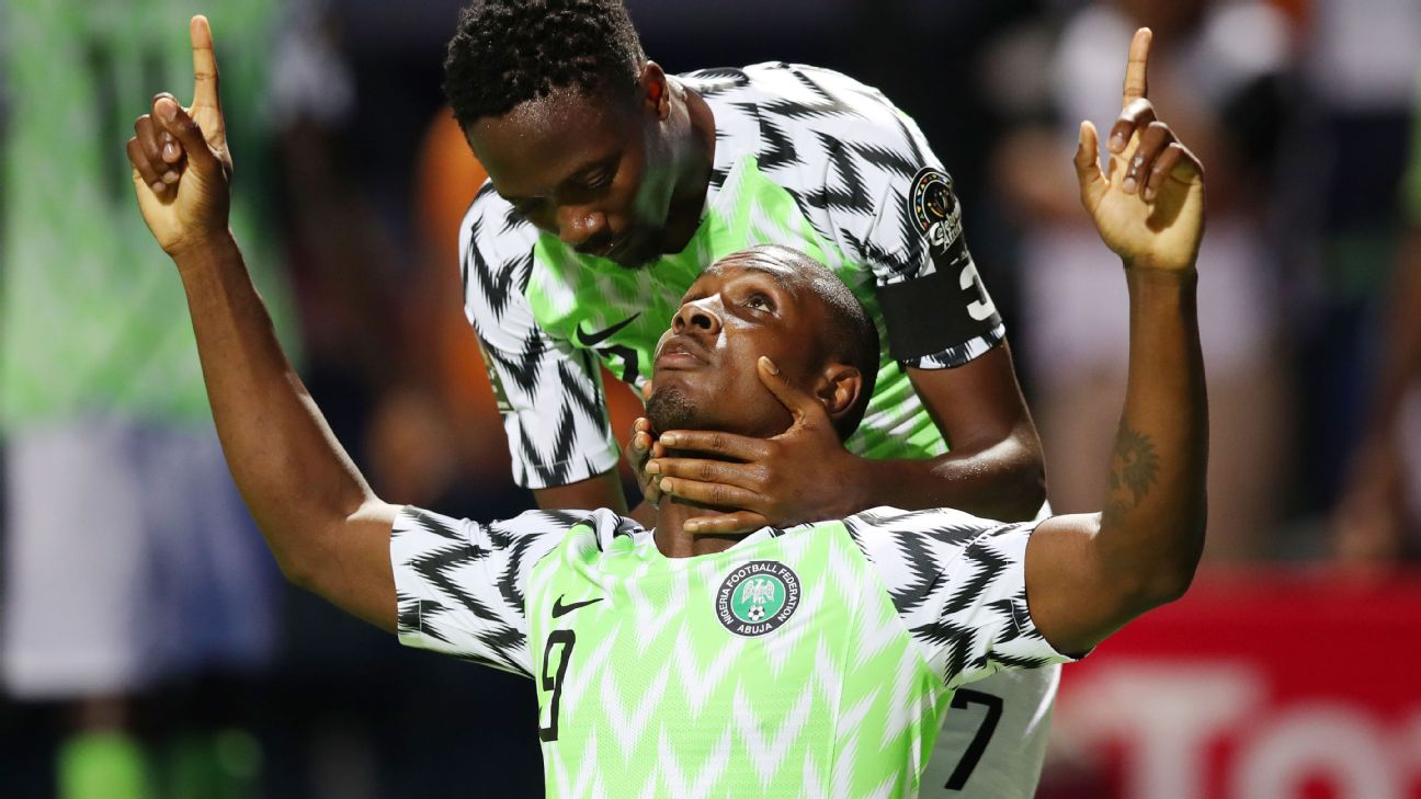 Odion Ighalo celebrates with Ahmed Musa after scoring Nigeria's winning goal against Burundi in their opening Africa Cup of Nations match at Alexandria Stadium.