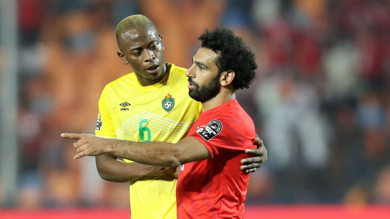 Alec Mudimu shares a word with Mohamed Salah after the Africa Cup of Nations-opening match between Egypt and Zimbabwe at Cairo International Stadium.