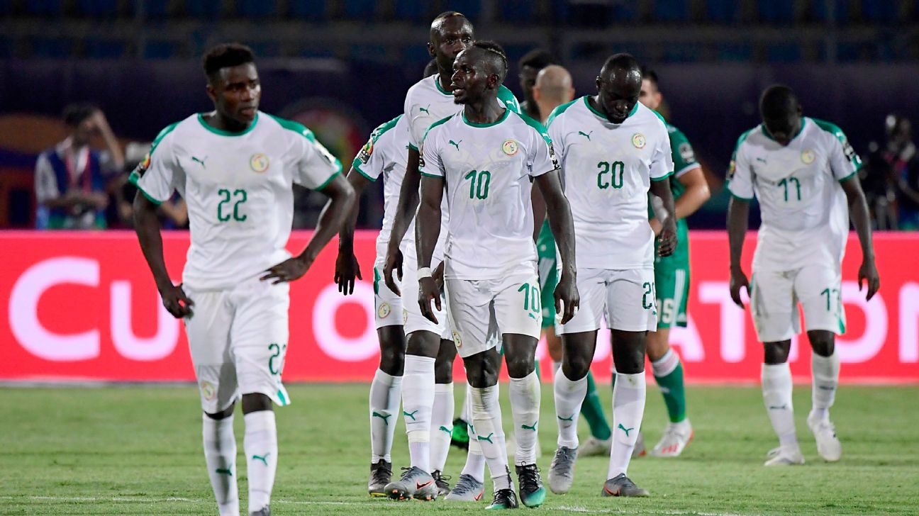 Senegal players react after losing their Africa Cup of Nations match to Algeria.