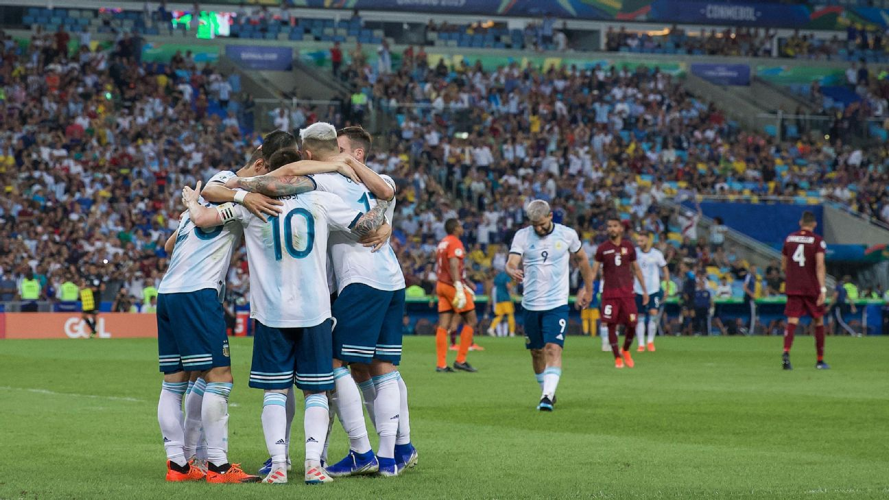Lionel Messi (10) celebrates with Argentina teammates after they scored a goal against Venezuela at the Copa America.