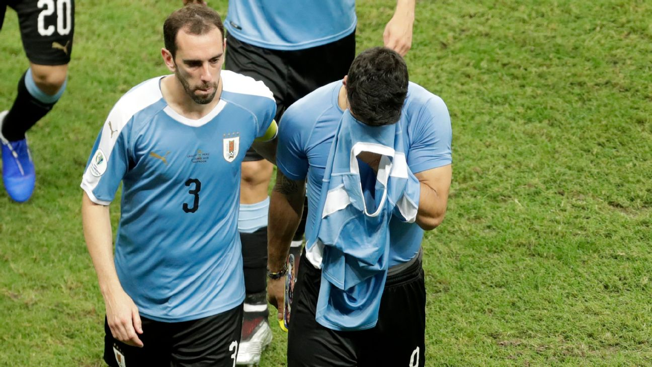 Uruguay captain Diego Godin consoles Luis Suarez after the squad's quarterfinal loss to Peru at the Copa America.