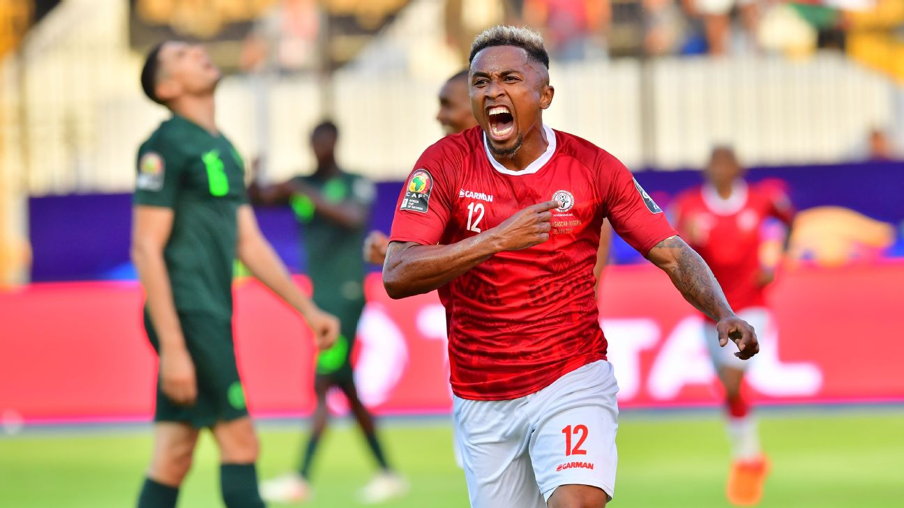 Lalaina Nomenjanahary celebrates during Madagascar's Africa Cup of Nations match against Nigeria.