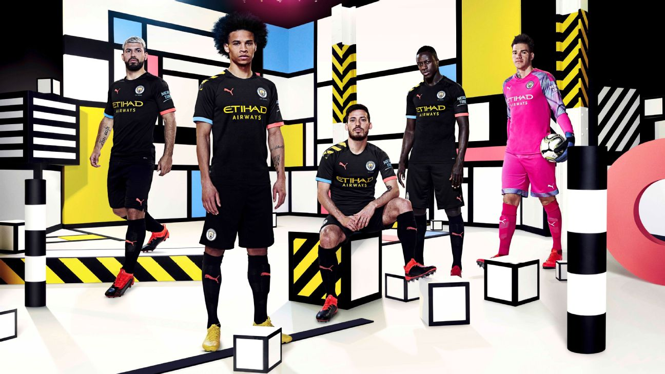 Manchester City players model their team's new away kits for the 2019-20 season.